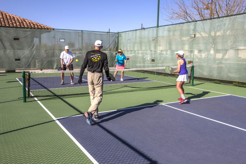 4 Players on court playing Pickleball - Pickleball Active Adult Community Saddlebrooke Ranch Oracle, AZ